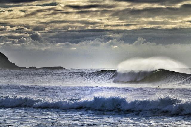 surfer surfing waves at gerringong beach sydney australia