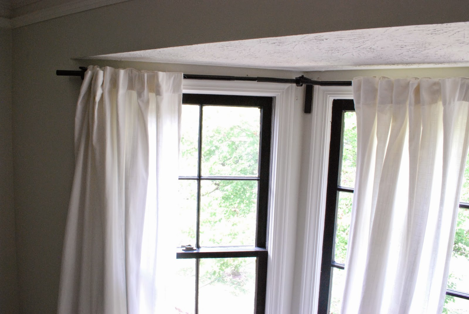between blue and yellow bay window curtain rod. Black Bedroom Furniture Sets. Home Design Ideas