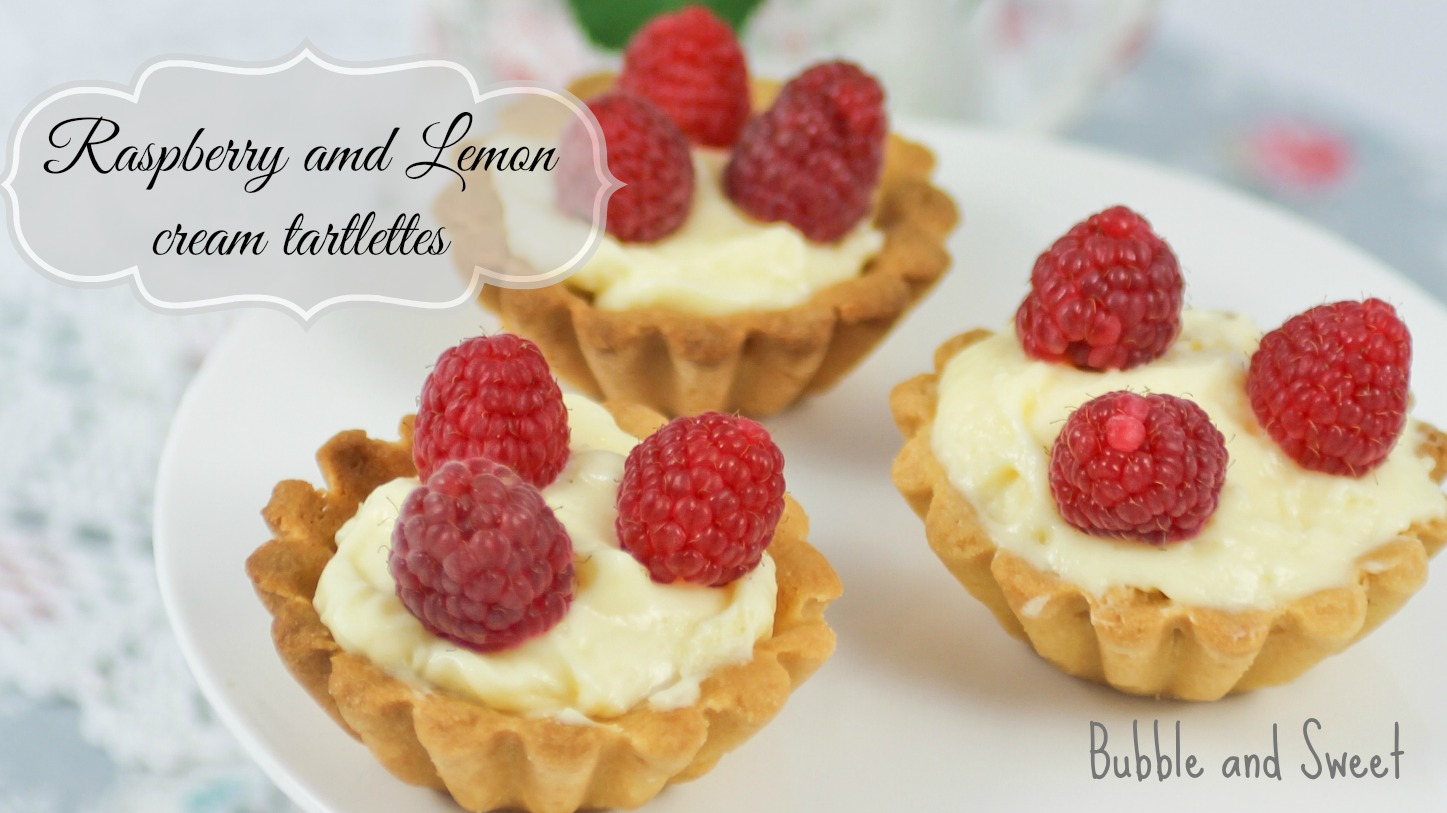 bubble and sweet lemon cream curd and raspberry tartlettes