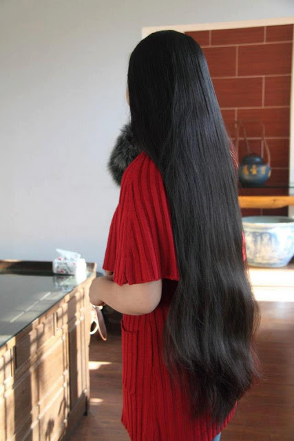 Young Kerala girl at a star hotel with loose long hair.