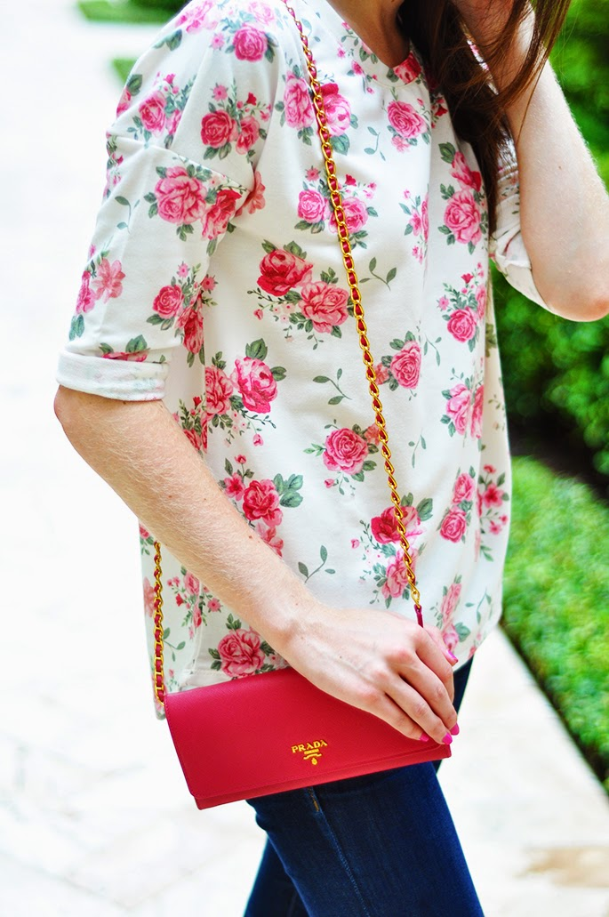 Pink Prada saffiano wallet on a chain