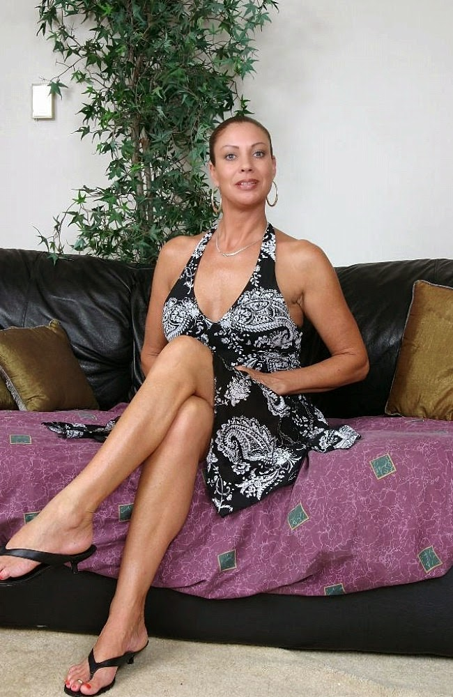 Vanessa Videl Crossed Her Legs Pulling Up Her Long Dress As She Did
