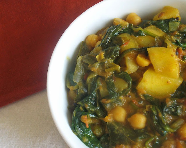 chickpea mango curry with spinach in a tomato coconut gravy