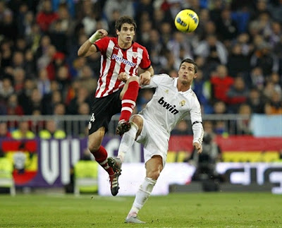 Javi Martinez playing for Athletic Bilbao against Cristiano Ronaldo