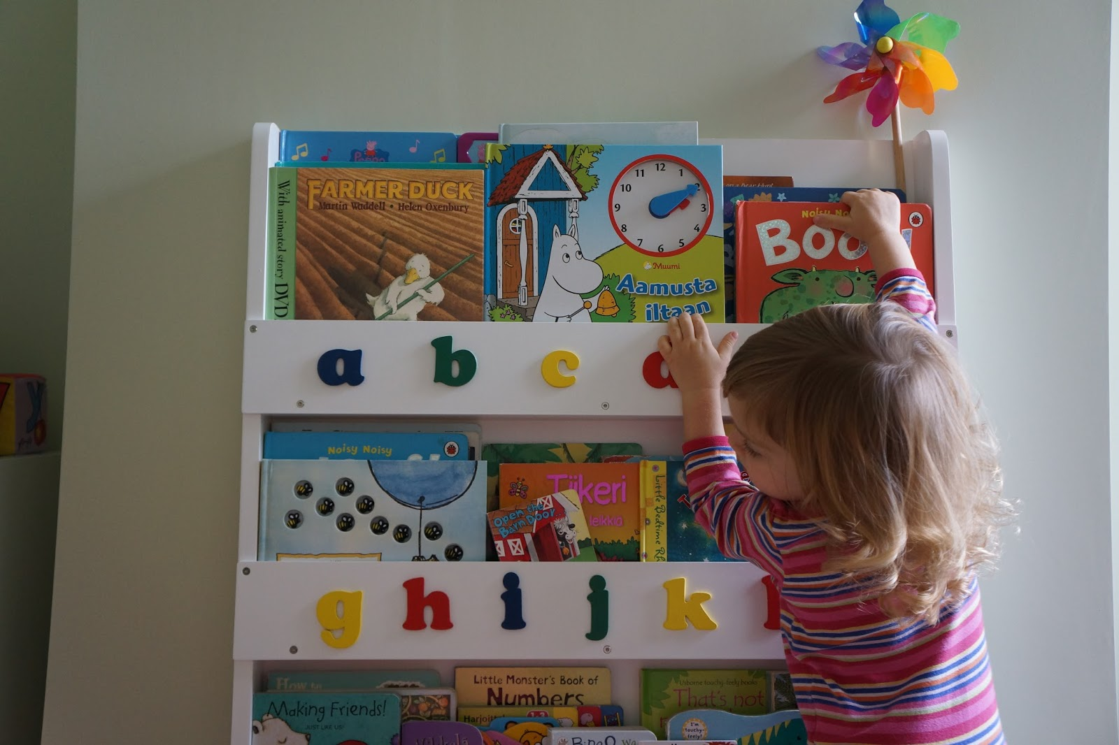 tidy books bookcase toddler reaching for books