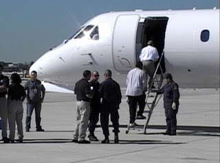 U.S. Marshals transport federal detainee around the world by plane.