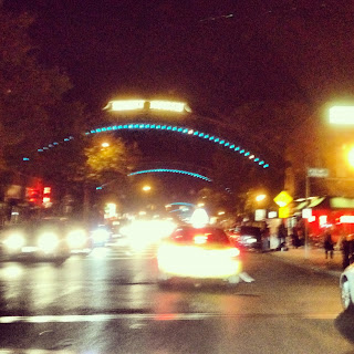 Arches across High Street at night in Columbus' Short North