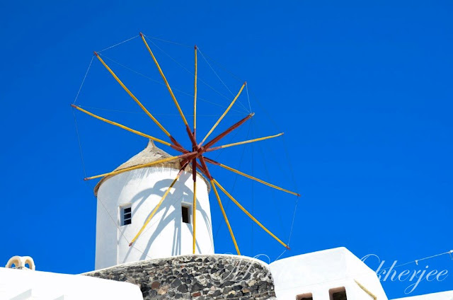 Windmill Oia Santorini Greece by Monika Mukherjee