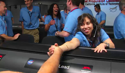 Curiosity MSL lands on Mars. Entry, Descent and Landing (EDL) team in blue shirts celebrate touchdown on Mars. 6 August 2012. NASA/JPL.