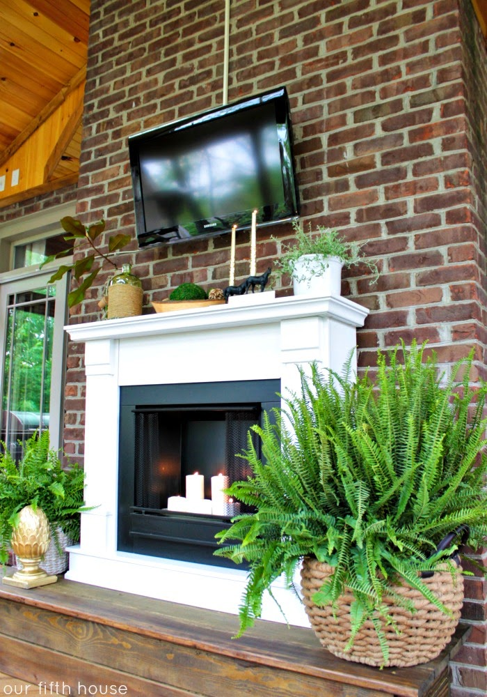 our fifth house - screened porch fireplace