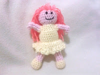 Crocheted amigurumi toy dolly