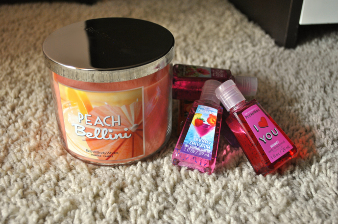 Bath & BodyWorks Peach Bellini candle, sanitizer, Berry Sangria, Bouquet, Aloha Orchid, Fresh Picked Tangerines, and Fresh Picked First Bloom