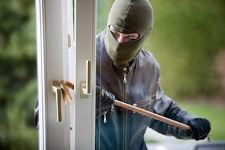 Joke- Robber going out through entrance.