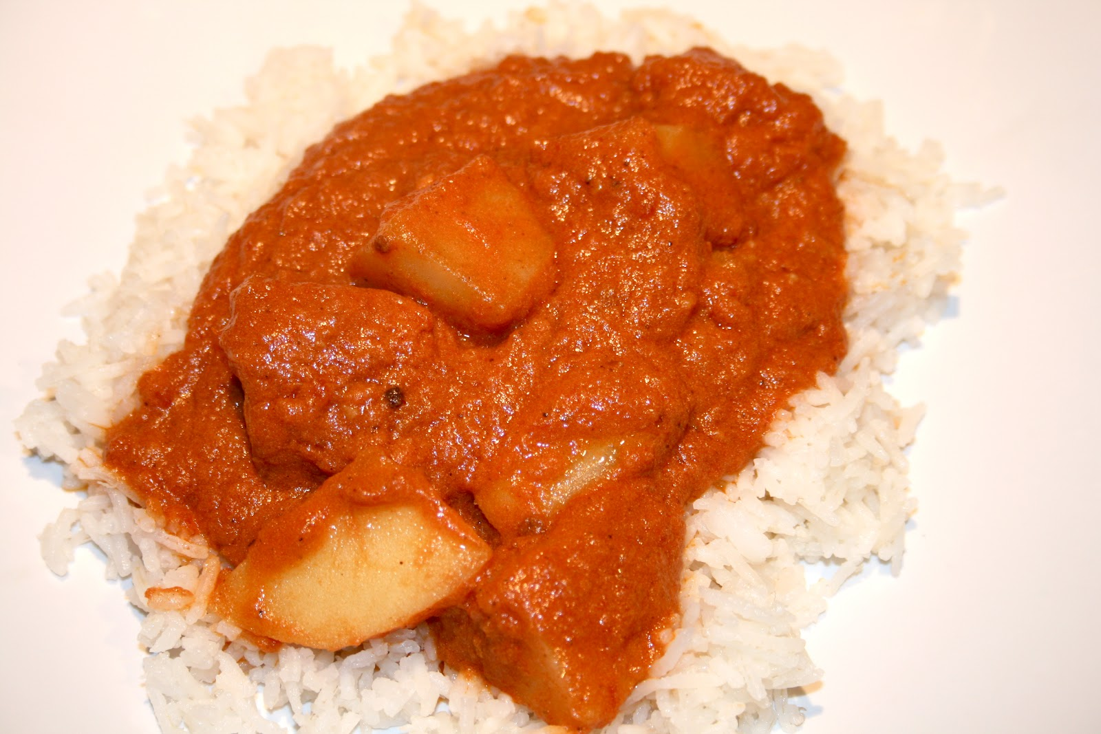 sugar & spice: Potatoes in a Creamy Tomato Gravy