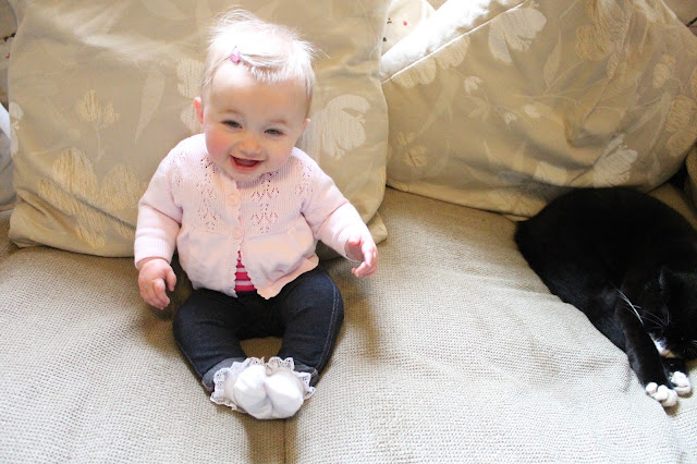baby wearing frilly white socks, jeggings and pink cardigan from asda