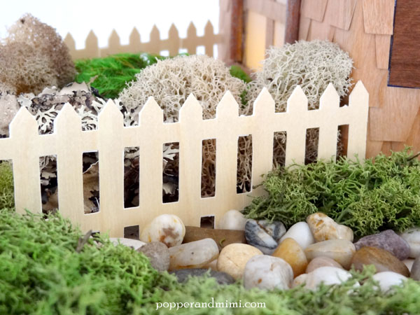 DIY Rustic Woodland Party Decor Centerpiece die cut fence | popperandmimi.com