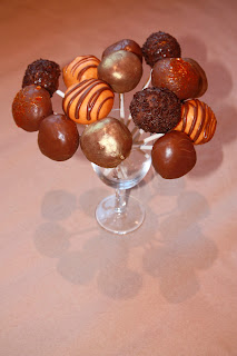 Chocolate orange cake pops displayed in a wine glass