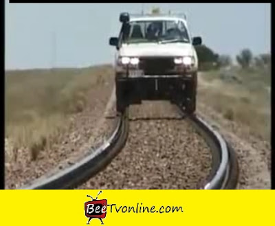 CAR ON RAILWAY TRACK