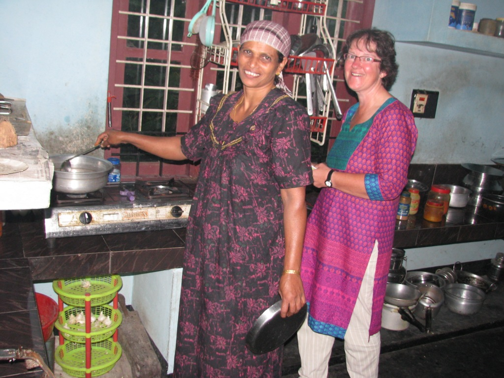 Guests learning cooking at Bamboo Village home stay, Wayanad, Kerala