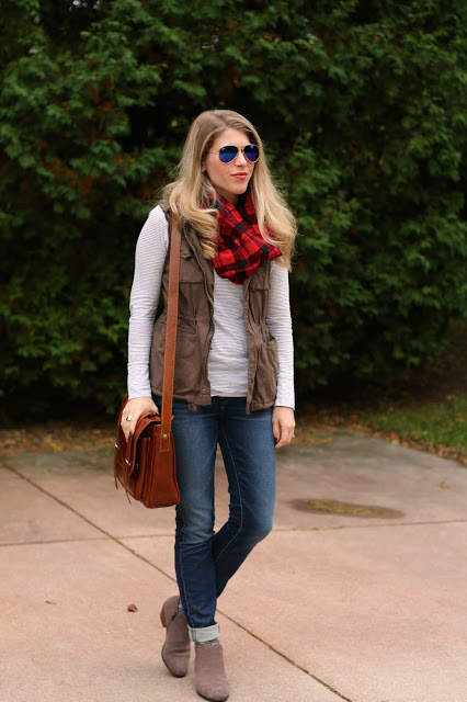 Casual striped tee, jeans, utility vest, and booties