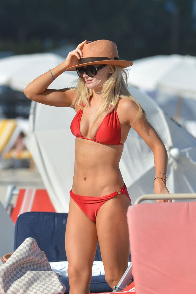 Emma Rigby flaunts toned stomach in red bikini in Miami