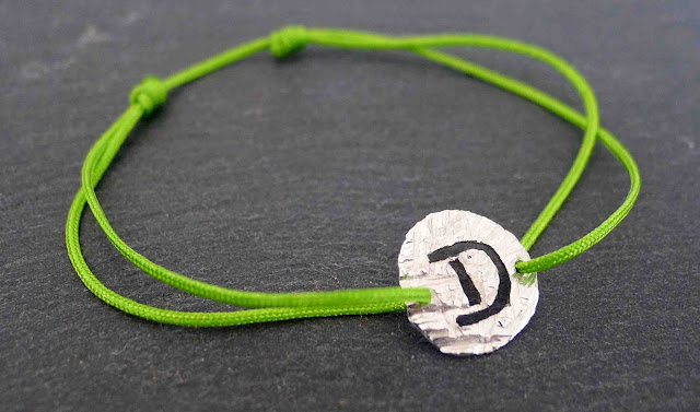 letter silver and cord bracelet