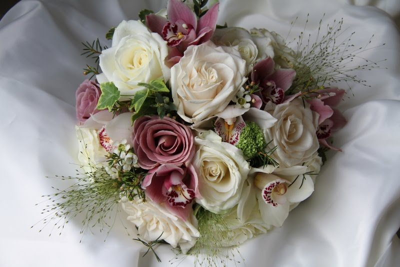 The flower magician soft gentle romantic blousy beautiful cream vendella roses dusky pink orchids vanilla and amnesia roses champagne grass gathered together to create a delicious vintage wedding bouquet mightylinksfo