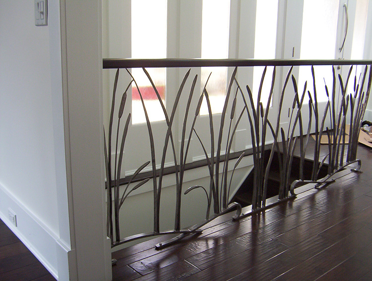 Wrought iron in interior design house interior decoration for Interior iron railing designs
