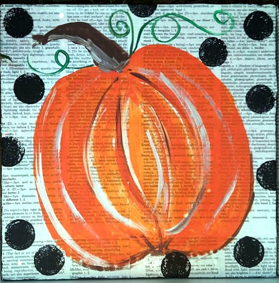 Paint a pumpkin over old artwork at www.diybeautify.com