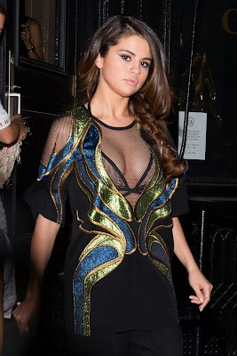 Selena Gomez shows cleavage wearing Gucci Spring 2014