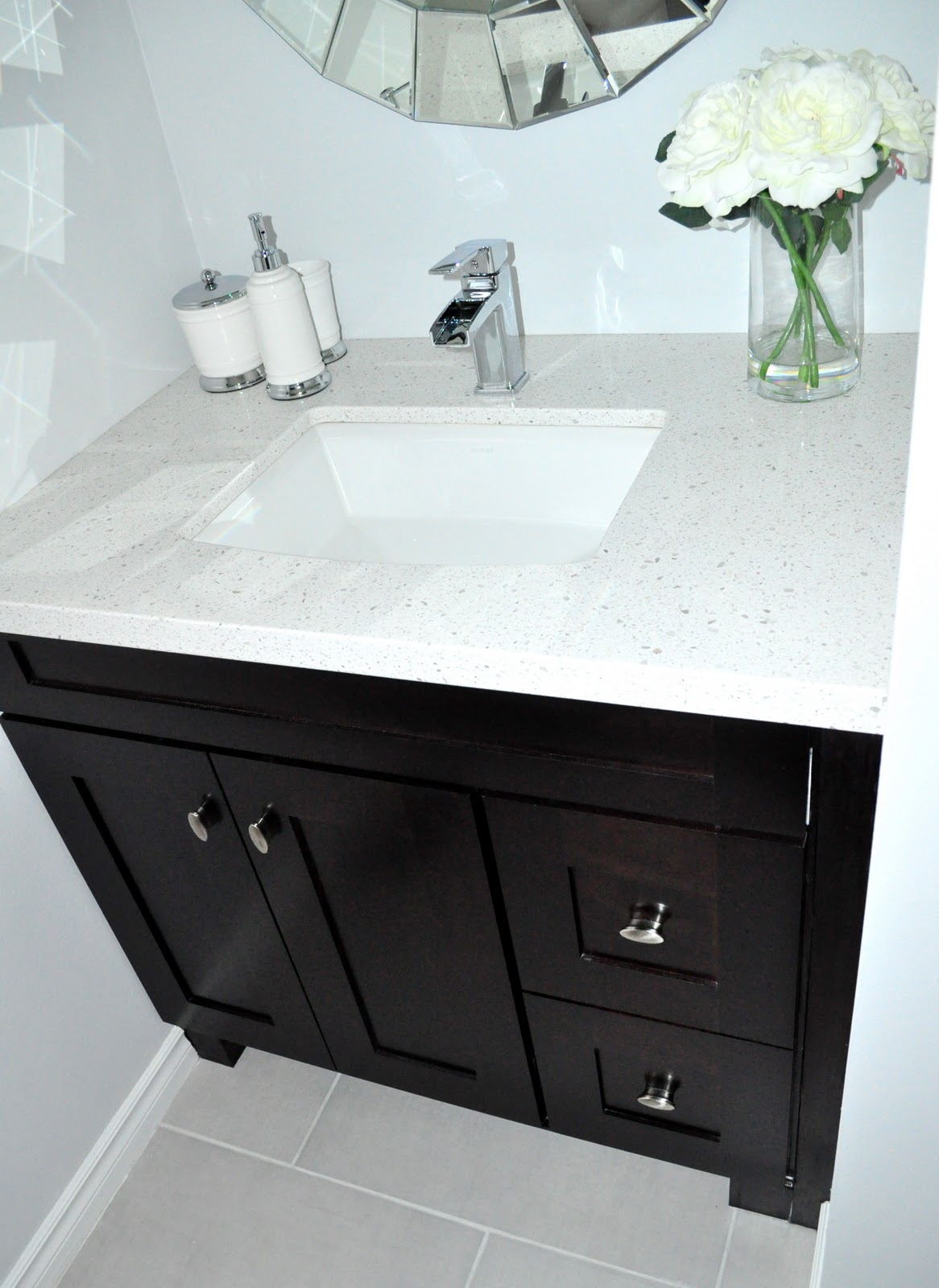 Living beautifully one diy step at a time bathroom for Pictures of bathrooms with black vanities