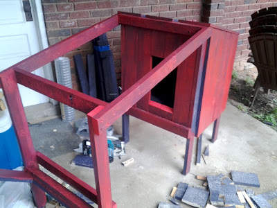 framing for the open portion of the rabbit hutch is begun, front door is tested