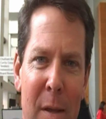 The One Who Did The Dirty Deed: Georgia Secretary of State Brian Kemp.  (Screen capture from YouTube video)