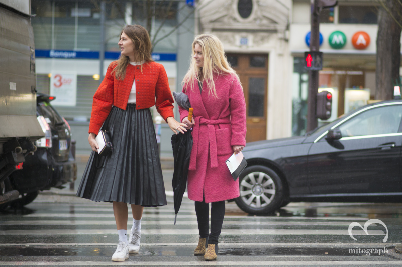 Stephanie Gundelach and Helene Skytte is trying to accross the street during Paris Fashion Week PFW 2014 Fall Winter Season