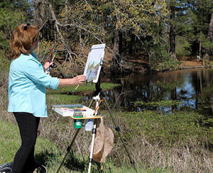 Donna painting at Camp Road