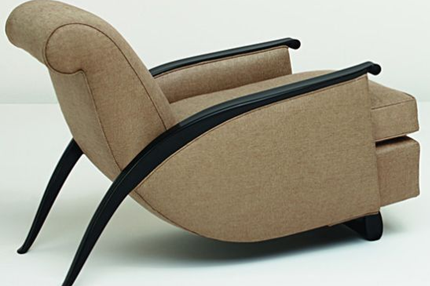 brown Gonse armchair designed by Andre Groult