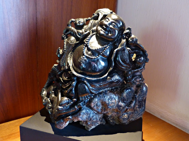 Black sapphire sculpture of Happy Buddha and attendant boys