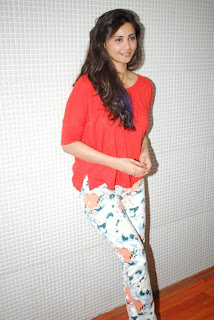 Daisy Shah looks super cute in White Leggings and Orange Top at New Years Eve