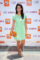 Angie Harmon posing for cameras in a green dress in Beverly Hills