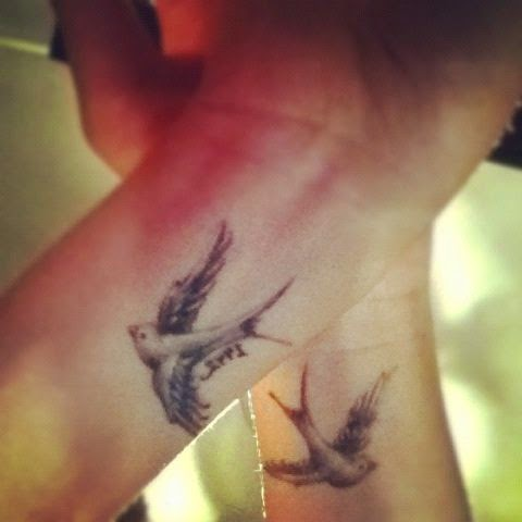 ♥ ♫ ♥ Swallow wrist tattoos. The swallow is a bird that chooses a mate for life and will only nest with that bird and no other. Therefore a swallow tattoo is also a symbol of love & loyalty. Swallow pairs travel long distances, only to find their way back to each other at home. ♥ ♫ ♥