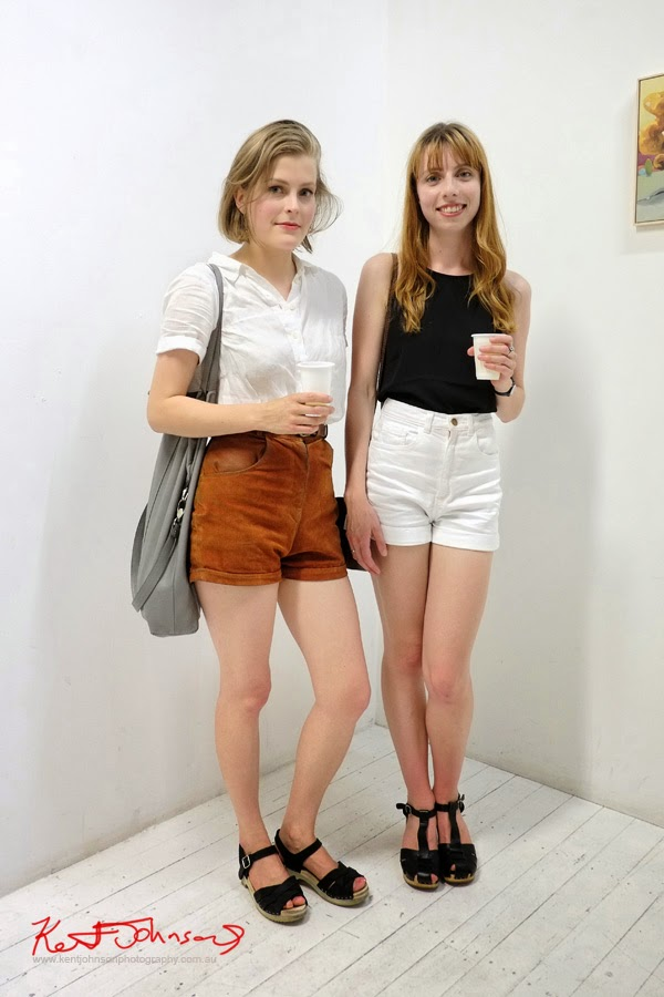 Two young women dressed in summer fashion, black accents; at China Heights gallery - Photography by Kent Johnson.