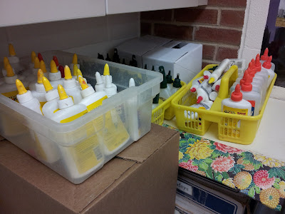 Our art teacher's partial stash of Elmer's glue bottles awaiting recycling