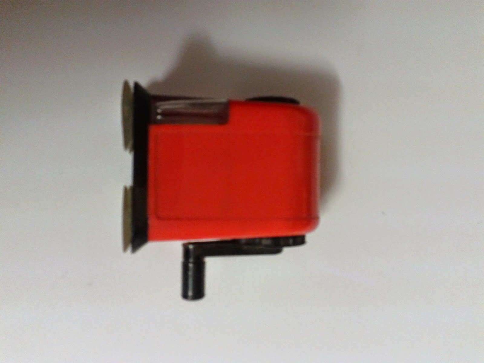 Stock photo: Orange and black old school pencil sharpener