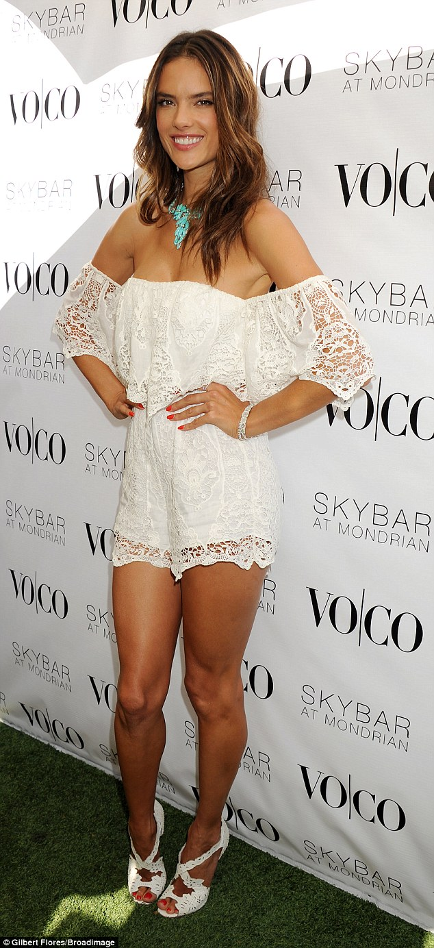 Alessandra Ambrosio is sexy in a lace playsuit at the VOCO LA party