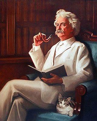 Mark Twain con uno de sus gatos