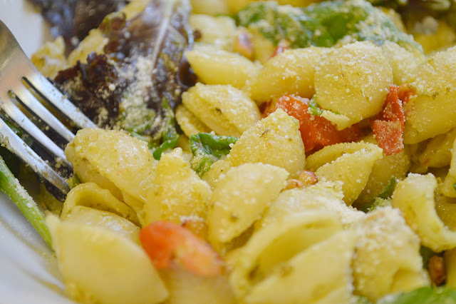 Pesto pasta salad with tomatoes and pine nuts