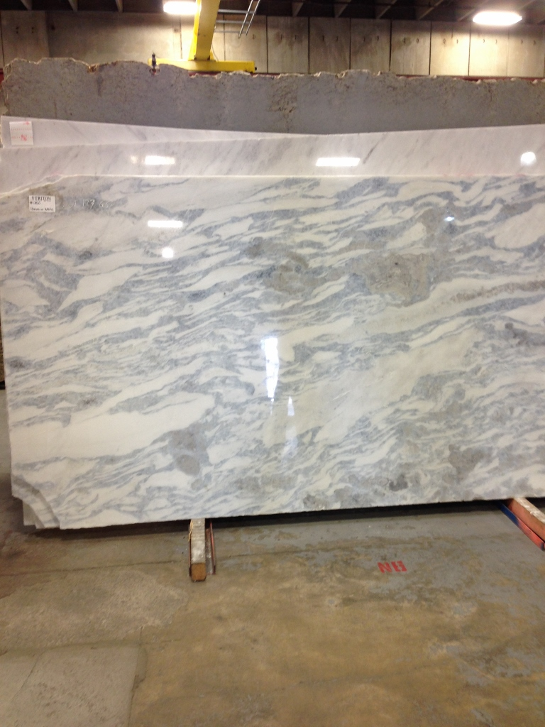 Granite Slab Yards : granite (?) slab with white, taupe, and blue movement.