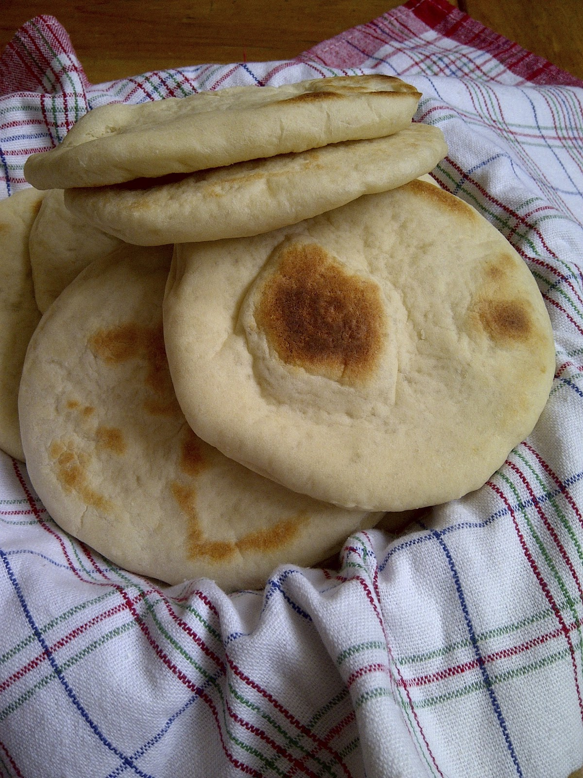 Greek Pitas ~ learn how to make these from scratch ~ www.soliloquyoffood.com via LoveBakesGoodCakes