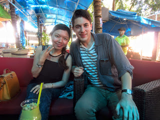 A Vietnamese girl and tourist pose at a restaurant in Dali, Vietnam