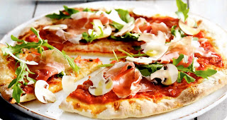 Classic light and crispy pizza base topped with red sauce, ham, mushrooms and rocket (arugula) leaves